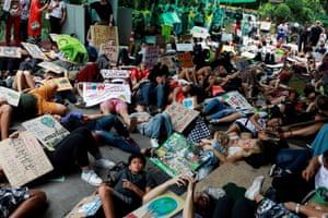Environmental activists play dead in Bangkok, Thailand