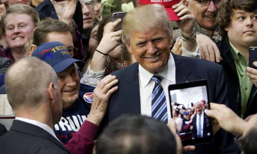 Donald Trump poses for a photo with a supporter in Plymouth, New Hampshire.