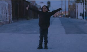 A child finishes his dance before a line of police officers dressed in riot gear, in the video for Beyoncé's new video, Formation