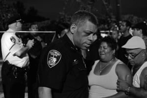 An exhausted Baltimore city police officer