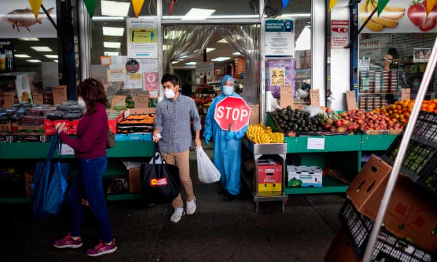 Managing the flow of customers at a grocery store in Queens.