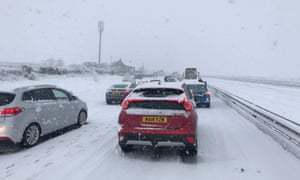 Cars stuck in the snow on the A30.