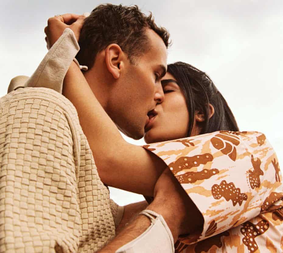 Head shot of couple Jordan Derrien (27) and Rosaline Shahnavaz (30) kissing, May 2021