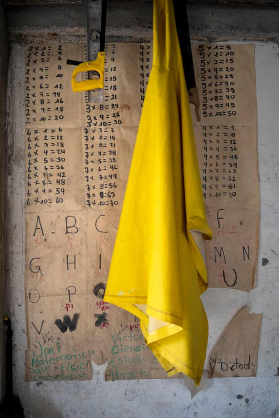 A poster of alphabet and multiplication tables in the living room of the Ayoví family at Playa de Oro. Parents have to create different learning resources for their children to face the struggles of home education