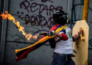 Caracas, Venezuela: An opposition activist clashes with police during a march towards the supreme court of justice