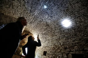 Anne Youngman looks for bats sleeping in crevices in a cellar