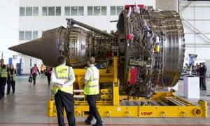 Staff examine a Rolls-Royce Trent 1000 turbofan engine
