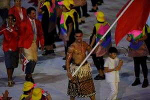 A bare-chested Pita Nikolas Taufatofua leads the Tongan delegation.