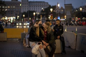 Barcelona, Spain A couple kiss in downtown Barcelona. Spain's Parliament has endorsed an extension of the state of emergency declared by the government until May 9. The measure puts into place a nightly curfew and allows regions to impose more restrictions