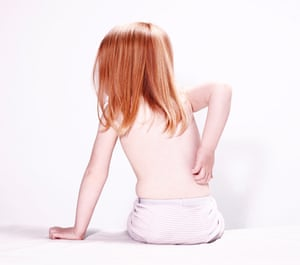 A young model scratches her back