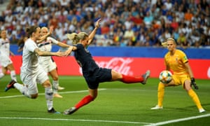 France's Amandine Henry stretches for a shot but can't get the ball on target.