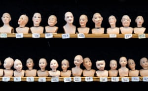 London, UK Miniature dolls heads on display at the City of London Dollshouse Festival. The festival showcases the top craftsmen and craft suppliers specialising in all areas of miniatures and model-making
