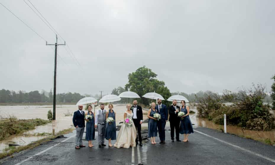Kate Fotheringham and Wayne Bell on their wedding day image taken on Gloucester Road Wingham. NSW, Australia. Floods, flooding.