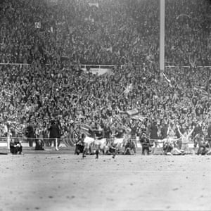Wembley erupts as Martin Peters is congratulated by team-mate Geoff Hurst, centre, after his header put Engalnd ahead with 12 minutes to go