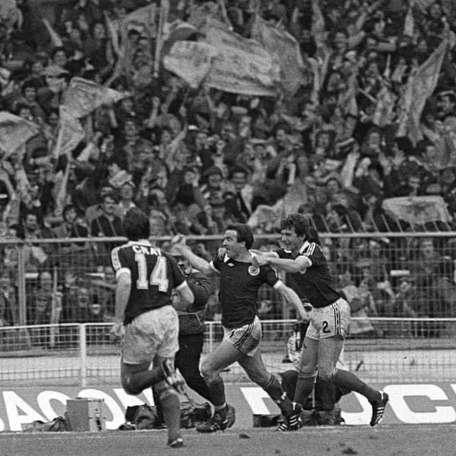 Scotland's John Robertson celebrates his goal with Ray Stewart in front of jubilant Scotland fans at Wembley in 1981