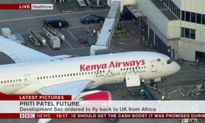 The Kenya Airways plane thought to be carrying Priti Patel - and ministerial-style limos waiting alongside