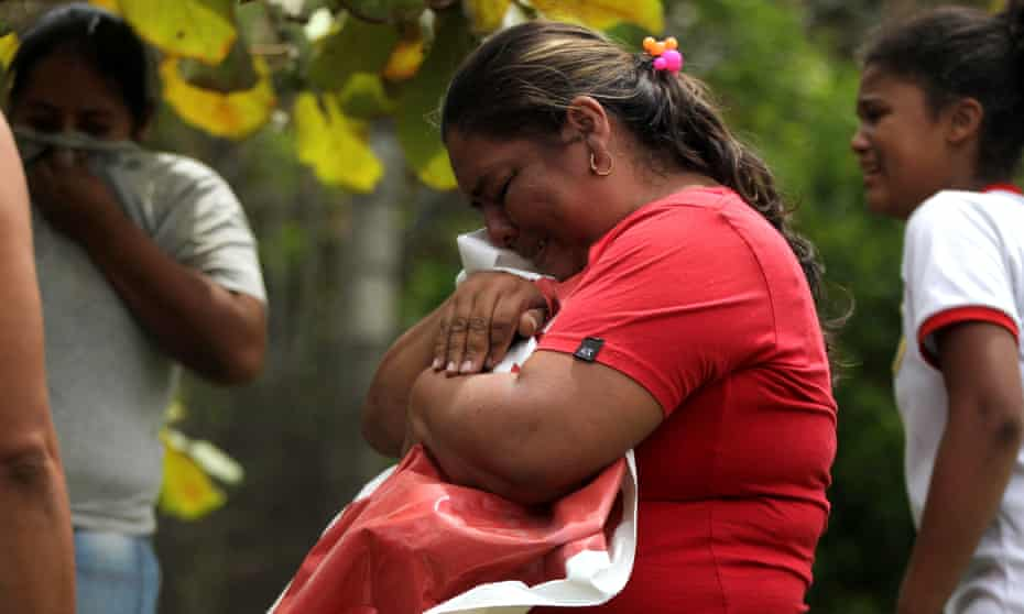 Locals in Suarez mourn the death of Karina García. The string of political killings has shaken the country.