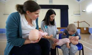 Doctor giving child and mother life-saving lesson