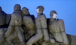 Statues of the Monumento das Bandeiras are seen with face masks during the spread of the coronavirus disease in Sao Paulo, Brazil, 12 May 2020.