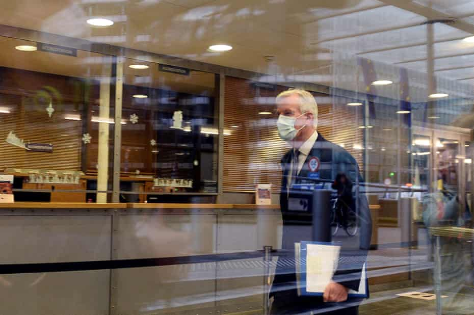 Barnier leaves the EU commission building in Brussels, 22 December