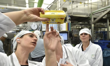 A worker inspects a tub of margarine at a Unilever factory. The company is overhauling its traditional method of recruitment.