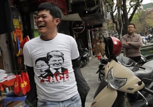 A man wears a T-shirt with portraits of President Trump and North Korean leader Kim Jong-un in Hanoi