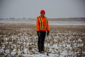 Neil Shaffer posed in the barren fields he used to farm in Cresco, Iowa on Thursday, December 12th. Photo by Jordan Gale