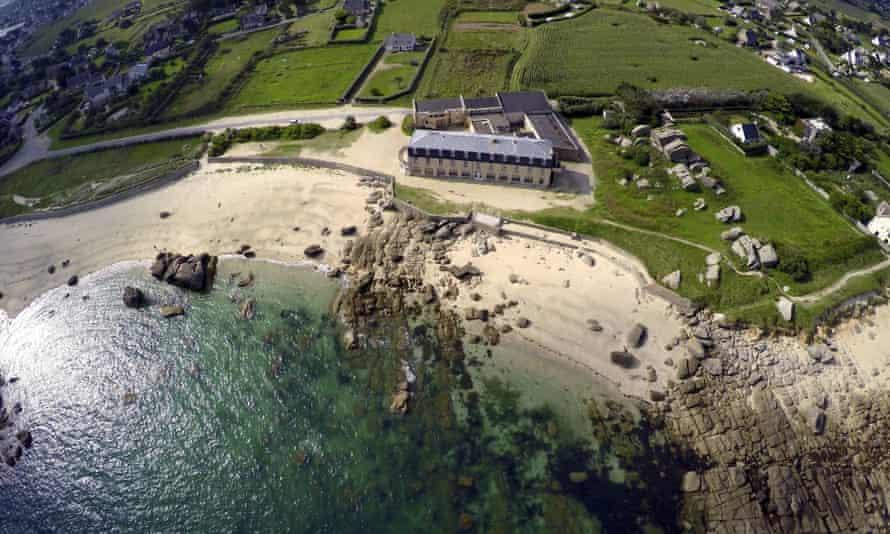 Aerial view of Hôtel de La Mer, Brignogan Plage, Brittany looking down onto beach and rocks too
