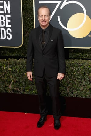 Bob Odenkirk, star of Better Call Saul, arrives in all black and wearing the #TimesUpNow badge.