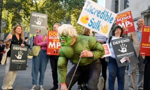 A protester mocking Boris Johnson's suggestion that he, or the UK, was like the Incredible Hulk.