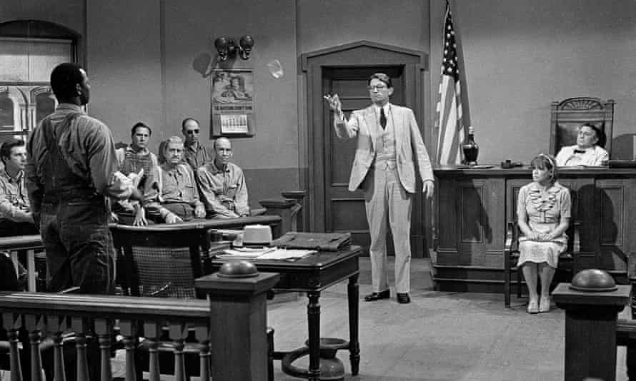 Gregory Peck appears as lawyer Atticus Finch with Brock Peters as Tom Robinson in the 1962 film adaptation of To Kill a Mockingbird.
