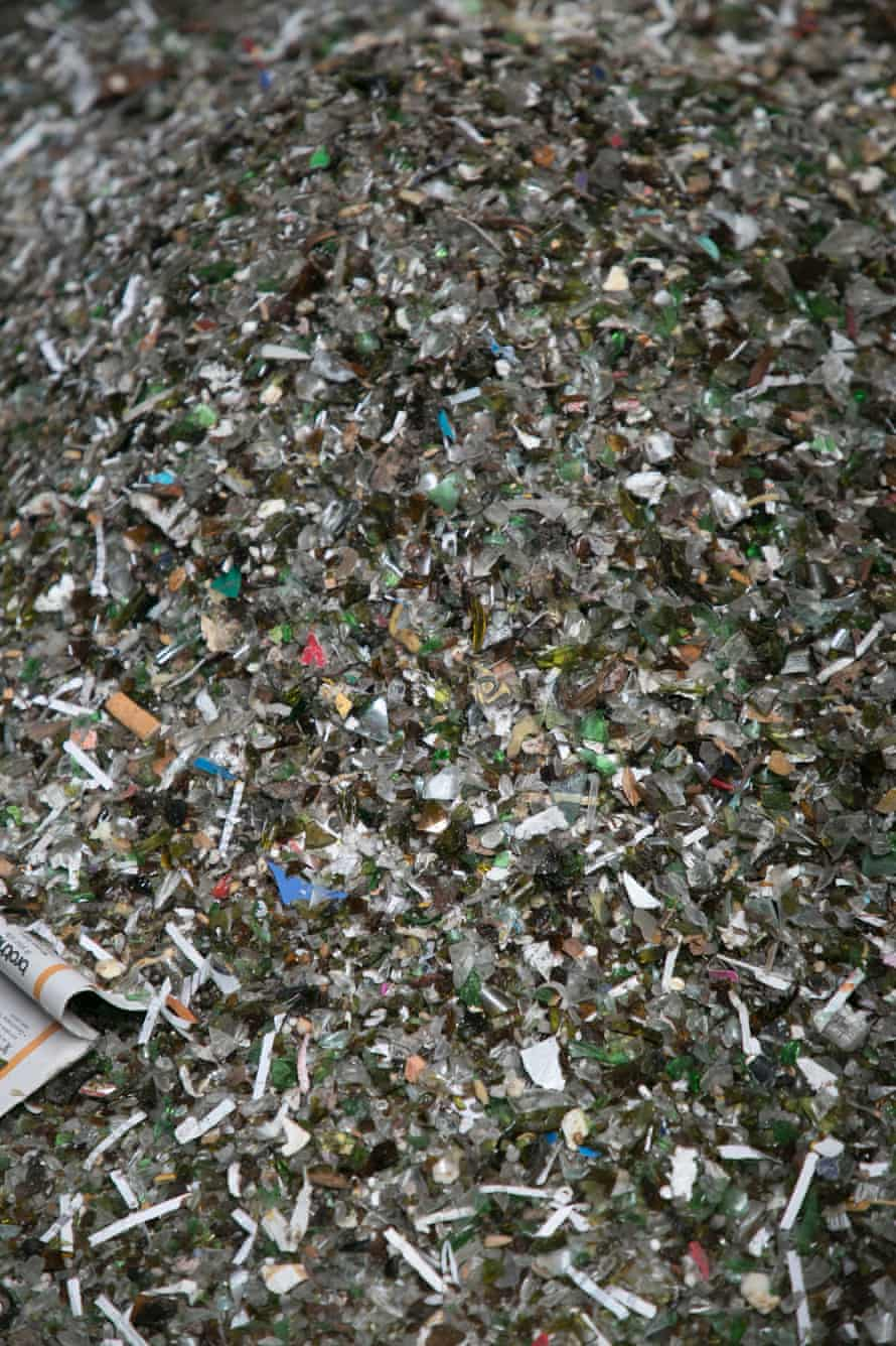 Small pieces of plastic and paper have to be removed from the glass. To do this, the recycler uses implosion technology to shatter glass while the contaminants remain of a larger size, and can then be screened out of the glass sand.