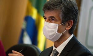 Brazilian Minister of Health Nelson Teich wearing a face mask reacts during the press conference to announce his resignation from office at the Ministry of Health on 15 May 2020 in Brasilia.