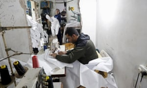 For the first time in years, some sewing factories in the Gaza Strip are back to working at full capacity — producing masks, gloves and protective gowns, some of which are bound for Israel. Credit: Photo/Adel Hana