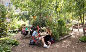 Cafe tables at Dalston Eastern Curve Garden, Hackney,