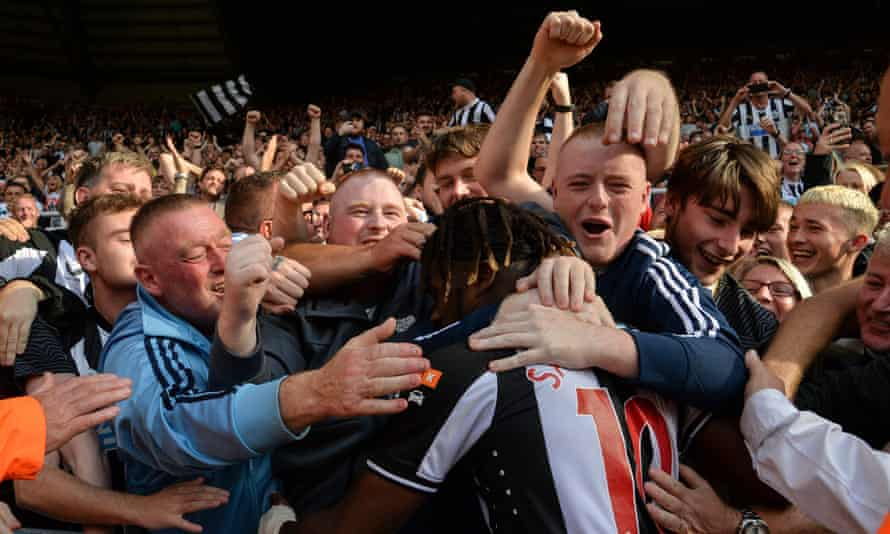 Allan Saint-Maximin is mobbed by Newcastle fans after scoring against Southampton this season.