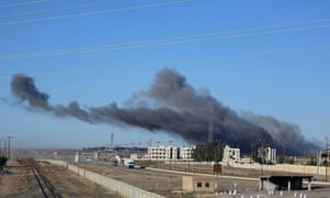 Smoke rising in the aftermath of an airstrike that targeted areas in Raqqa, Syria.