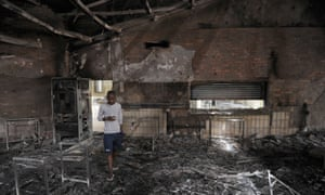 A student walks through the remains of the science center at the North-West University in Mahikeng, South Africa.