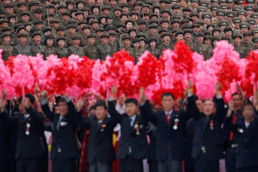 Rally participants shout slogans during the mass rally in Pyongyang.