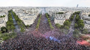 An image taken from the top of the Arc de Triomphe shows the crowd celebrating France's victory on the Champs-Élysées in Paris