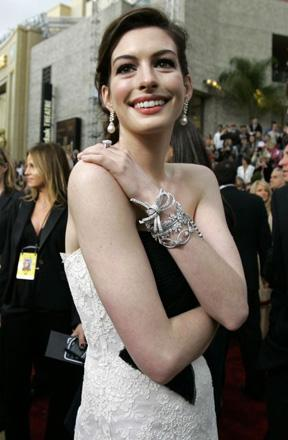 Anne Hathaway, also proving that it's a bit nippy over in LA today. See also: Jessica Biel.