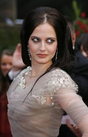 Eva Green, the most recent Bond girl, arrives. Casino Royale is nominated mostly in the technical categories, but we're glad Eva's made the trip over from France.