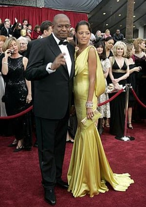 Forest Whitaker and wife Keisha. (You can't see it here, but Keisha's dress is quite daring at the back). Whitaker is tipped to win best actor for his portrayal of Idi Amin in The Last King of Scotland. Meanwhile, the woman behind him calls out for pizza.
