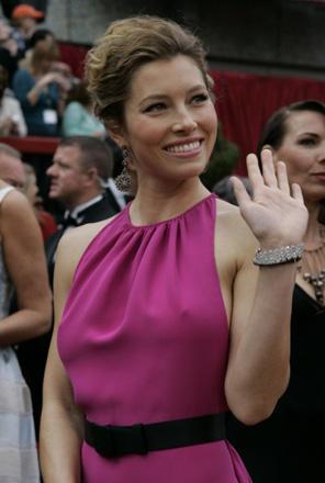 Jessica Biel arrives, wearing a fetching, but it seems insubstantial, purple number.