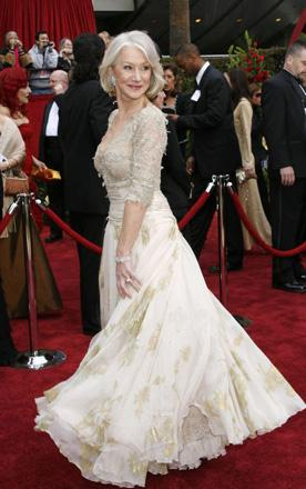 Helen Mirren, nominated, and favourite, to win best actress for the eponymous role in The Queen, shows off her dress. She arrived on the red carpet waving a union flag. God help us all.