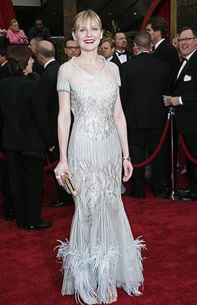 Kirsten Dunst; surely there are rules of thumb that tell pale ladies not to wear silver?