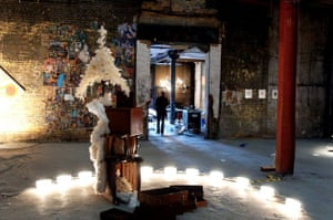 View of  Make Believe exhibition, including Jodie Careys' Furniture Arrangement II in an old warehouse just off Shoreditch High Street