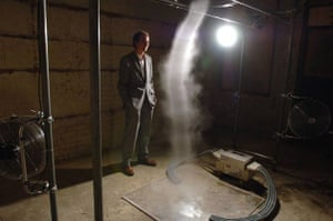 Alistair McClymont and his artwork Limitation of Logic and Absence of Certainty which is a tornado of water vapour created by electric fans, in the basement of of Shoreditch Town Hall as part of Concrete and Glass, an art and music festival, Shoreditch, London