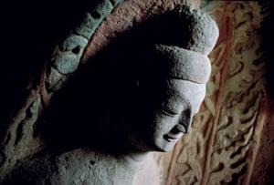 Colossal Buddha carved into cliffs at Yungang, Shanxi province, China (c490)