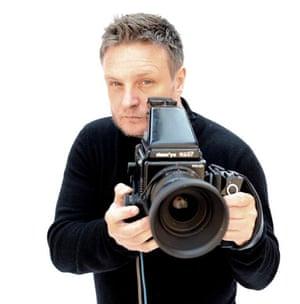 Rankin hold a camera
